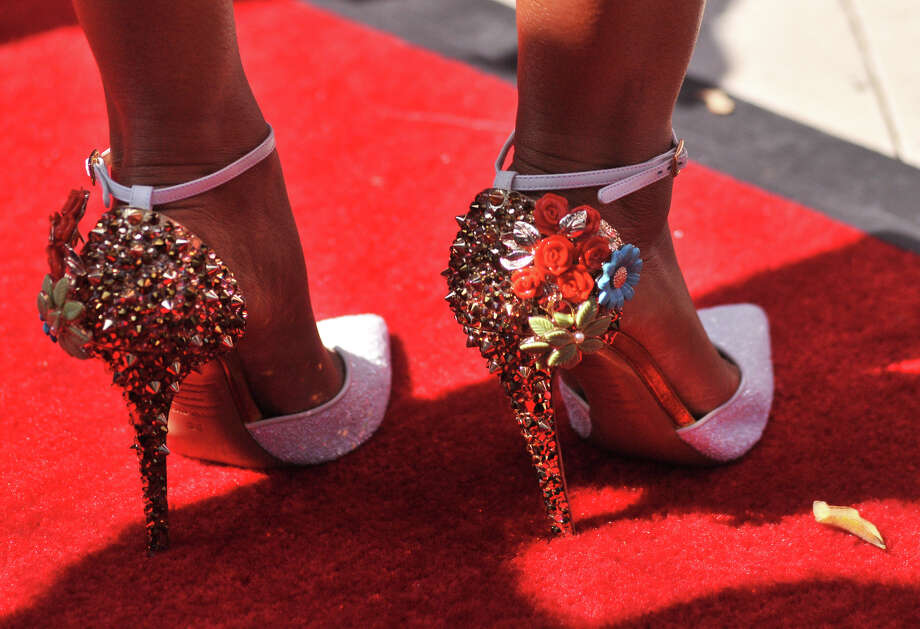 Mel B. wore some very sping looking shoes as she arrives on the red carpet in front of the Lila Cockrell Theater for a taping of the television show America's Got Talent Wednesday. Photo: Robin Jerstad