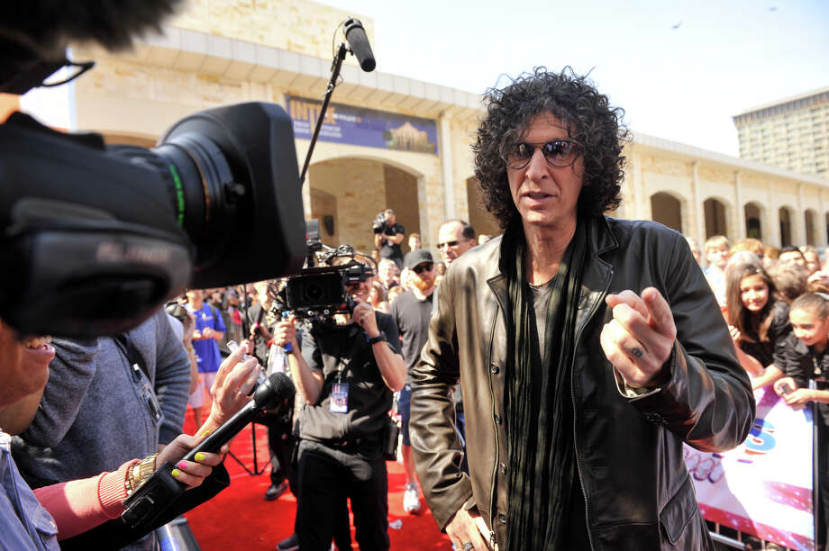 Howard Stern talks with reporters as he arrives on the red carpet in front of the Lila Cockrell Theater for a taping of the television show America's Got Talent Wednesday. Photo: Robin Jerstad