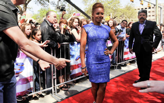 Mel B poses for photographers as she arrives on the red carpet in front of the Lila Cockrell Theater for a taping of the television show America's Got Talent Wednesday. Photo: Robin Jerstad