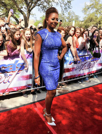 Mel B poses for photographers arrives on the red carpet in front of the Lila Cockrell Theater for a taping of the television show America's Got Talent Wednesday. Photo: Robin Jerstad
