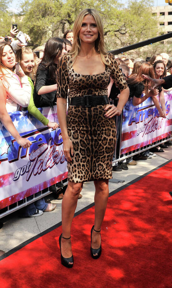 Heidi Klum poses for photographers as she arrives on the red carpet in front of the Lila Cockrell Theater for a taping of the television show America's Got Talent Wednesday. Photo: Robin Jerstad