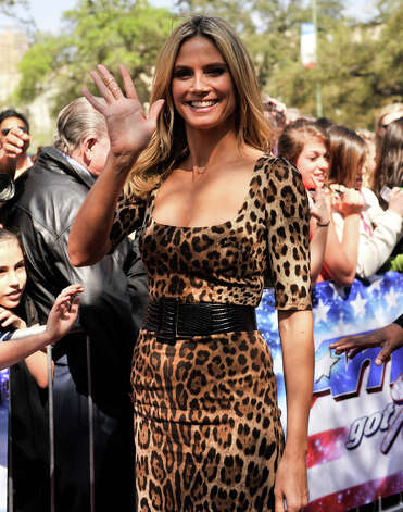 Heidi Klum waves as she arrives on the red carpet in front of the Lila Cockrell Theater for a taping of the television show America's Got Talent Wednesday. Photo: Robin Jerstad