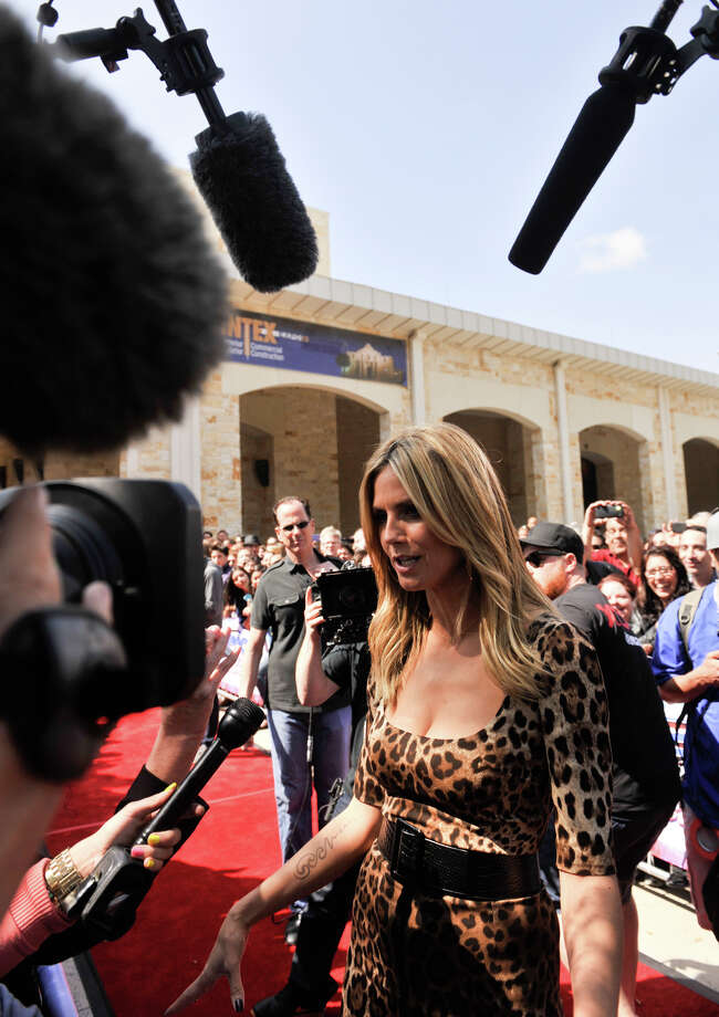 Heidi Klum talks with reporters as she arrives on the red carpet in front of the Lila Cockrell Theater for a taping of the television show America's Got Talent Wednesday. Photo: Robin Jerstad
