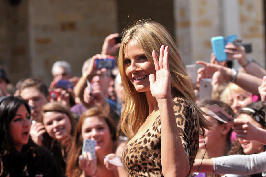 Heidi Klum arrives on the red carpet in front of the Lila Cockrell Theater for a taping of the television show America's Got Talent Wednesday. Photo: Robin Jerstad