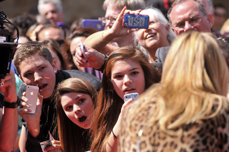 Crowds watch as Heidi Klum arrives in front of the Lila Cockrell Theater for a taping of the television show America's Got Talent Wednesday. Photo: Robin Jerstad