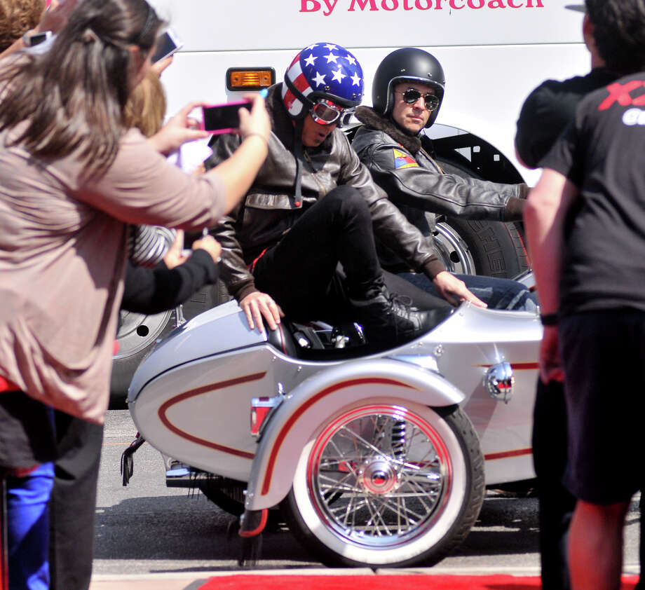 Howie Mandel arrives on the red carpet via a motorcycle sidecar in front of the Lila Cockrell Theater for a taping of the television show America's Got Talent Wednesday. Photo: Robin Jerstad