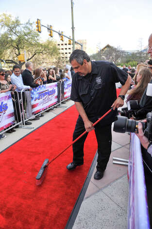 Adrian Arangua of the San Antonio Stagehands union sweeps prior to the judges arrival on the red carpet in front of the Lila Cockrell Theater for a taping of the television show America's Got Talent Wednesday. Photo: Robin Jerstad