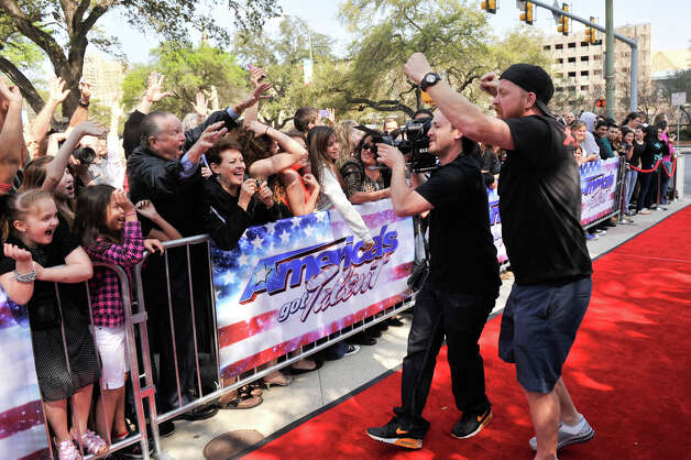Camera crews shoot fans prior to judges arriving  on the red carpet in front of the Lila Cockrell Theater for a taping of the television show America's Got Talent Wednesday. Photo: Robin Jerstad