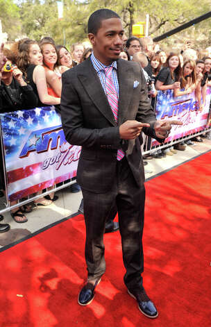 Nick Cannon arrives on the red carpet in front of the Lila Cockrell Theater for a taping of the television show America's Got Talent Wednesday. Photo: Robin Jerstad