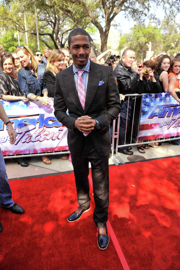 arrives on the red carpet in front of the Lila Cockrell Theater for a taping of the television show America's Got Talent Wednesday. Photo: Robin Jerstad