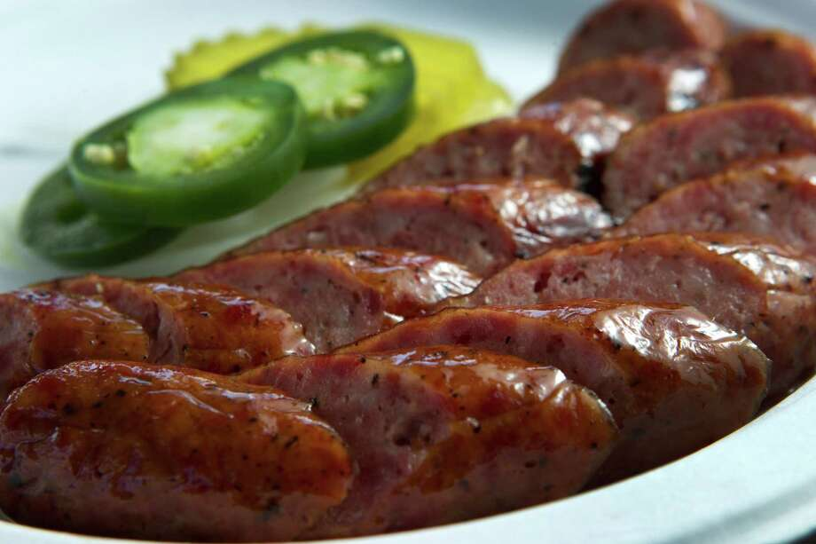Sausage and jalapeños are shown at Corkscrew BBQ. Photo: Brett Coomer, Houston Chronicle / © 2013 Houston Chronicle