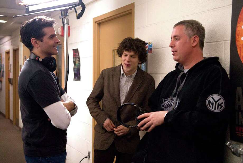 """Producer/director/screen writer/author David Levien, left, a Greenwich native, pauses on the set of """"Solitary Man"""" with actor Jesse Eisenberg, center, and Levian's filmmaking partner, Brian Koppelman. Photo: Contributed Photo"""