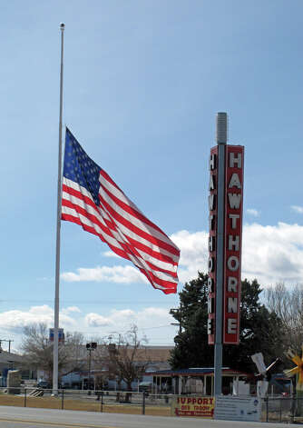 An American flag waves at half staff in the town of Hawthorne near the Hawthorne Army Depot on Tuesday, March 19, 2013, where seven Marines were killed and several others seriously injured in a training accident Monday night, about 150 miles southeast of Reno in Nevada's high desert. (AP Photo/Scott Sonner) Photo: AP