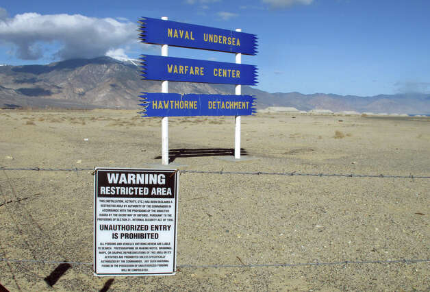 Signs are seen at the Hawthorne Army Depot on Tuesday, March 19, 2013, where seven Marines were killed and several others seriously injured in a training accident Monday night, about 150 miles southeast of Reno in Nevada's high desert. (AP Photo/Scott Sonner) Photo: AP