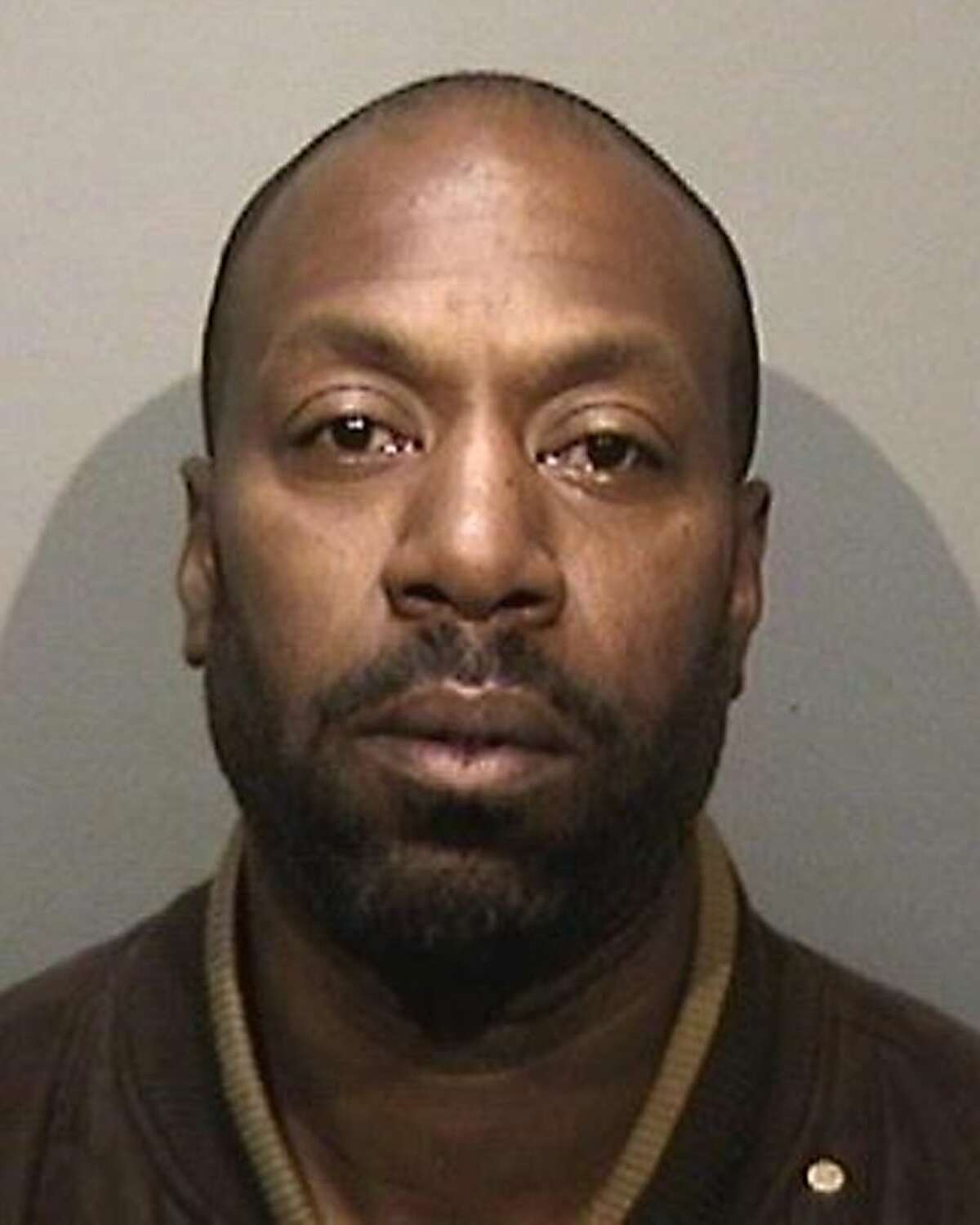 FILE - This booking photo provided by the Alameda County Sheriff's Department shows 45-year-old Andre Taray Franklin, who police arrested Sunday, March 3, 2013 in connection with the theft of a Gold Rush-era jewelry box from the Oakland Museum of California. Franklin, a parolee, is facing federal charges in the theft, authorities said. Franklin apparently stole the artifact valued at $805,000 earlier this year, sold it to a business owner for $1,500 and then threatened to report the owner to police if he didn't give him another $10,000, according to a criminal complaint filed last week in U.S. District Court in Oakland. (AP Photo/Alameda County Sheriff's Department)