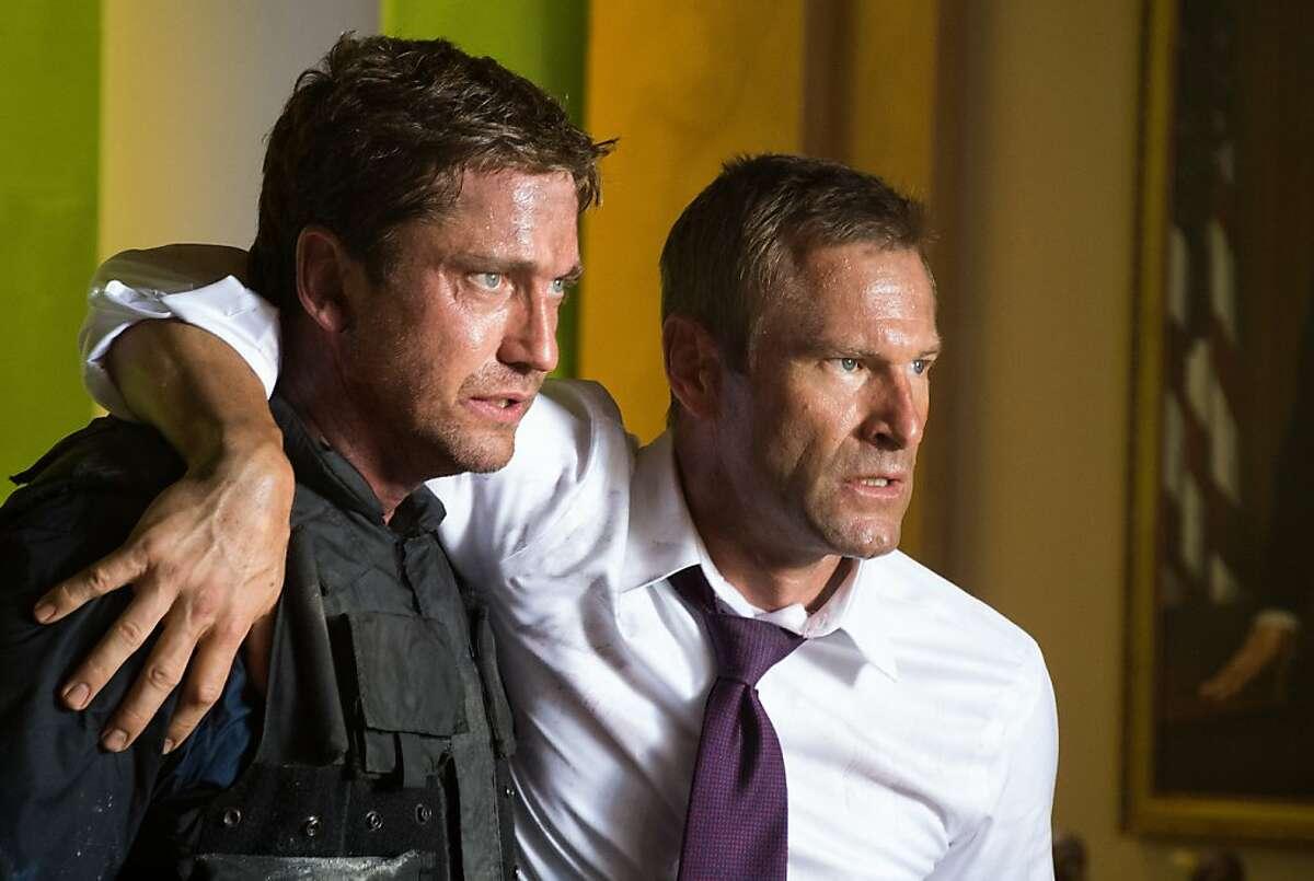 """Gerard Butler, left, and Aaron Eckhart star in, """"Olympus Has Fallen."""""""