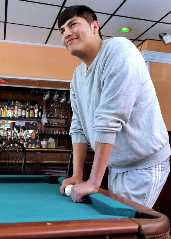 Jose Minchala, 21, of Danbury, came to the United States from Ecuador as a small child.  He spends much of his free time at the Ecuadorean restaurant, El Milenio, on North Street in Danbury, Conn. where he is photographed, Wednesday, March 20, 2013. Photo: Carol Kaliff / The News-Times