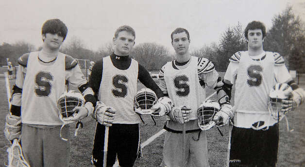 A 2008 Staples High School yearbook shows Roger Muchnick, second from left, in a photo of the  lacrosse team captains. at the Westport Public Library on Wednesday March 20 2013. A tablOthers in the photo, left to right, Jason Zins, Roger Muchnick, Zack Frimet and Dylan Bobrow. Photo: Christian Abraham / Connecticut Post
