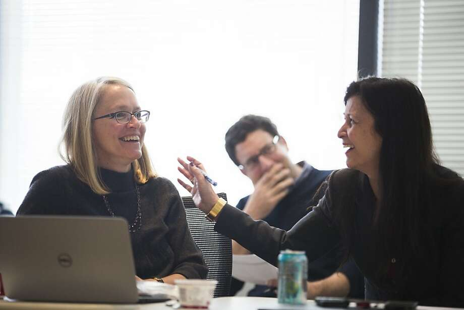 Dr. Bettina Steffen (left) and Dr. Ellen Feigal laugh while watching video pitches submitted by stem cell researchers. Photo: Stephen Lam, Special To The Chronicle