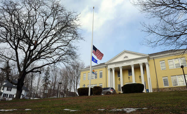 Westport Town Hall flies the flags in front at half staff on Wednesday March 20 2013 to pay respect to US Marine Roger Muchnick who was killed in a live fire training exercise in Nevada. Photo: Christian Abraham / Connecticut Post
