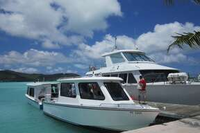 A private yacht greets guests and shuttles them to the Hiloton Bora Bora Nui Resort in style.