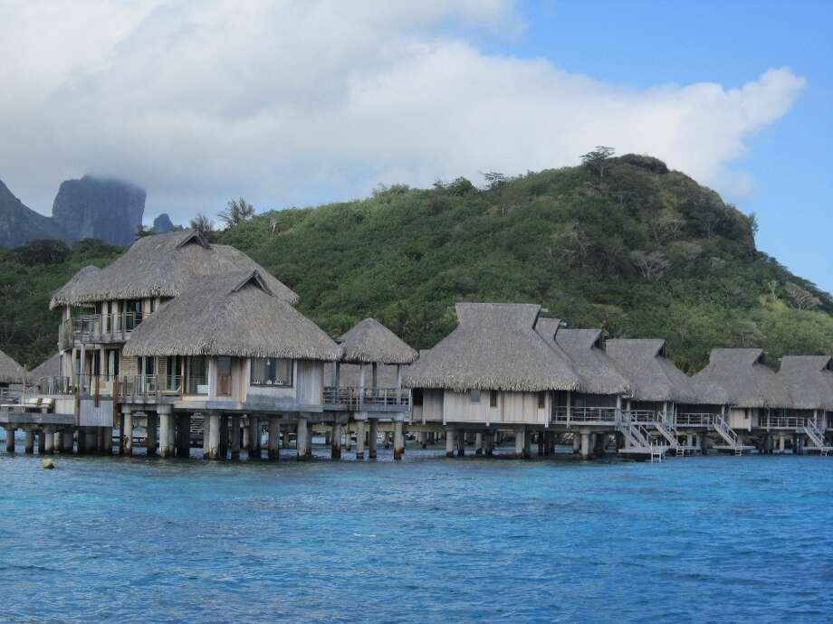 The luxurious 2-story Overwater Presidential Villas