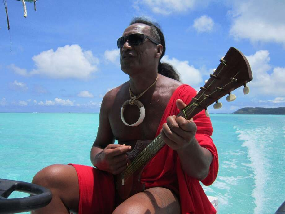 Patrick plays his ukele for guests on the Lagoon Safari Tour.