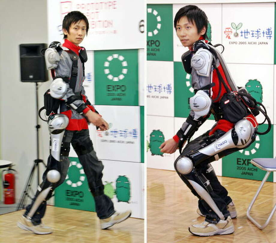 This combo picture shows Tsukuba University postgraduate student Takeru Sakurai demonstrates the usage of powered-suit 'HAL-5 (Hybrid Assistive Leg)' during a press preview of the prototype robot at the 2005 World Expo AIchi at Nagakute town near Nagoya, 10 May 2005. HAL-5, developed by Professor Yoshiyuki Sankai consist of control unit on the back, equipped with floor sensor attached on the sole of shoes used in balancing, and myoelectrical sensors to measure EMG on the thighs and upper arms for moving muscles and can be used to assist disabled or elderly people.AFP PHOTO / Yoshikazu TSUNO Photo: YOSHIKAZU TSUNO, Getty / 2005 AFP