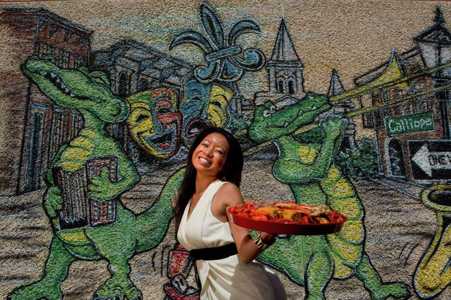 Louisiana native Lisa Carnley, owner of the Cajun Stop, outside of her restaurant. Photo: Johnny Hanson, Staff / © 2013  Houston Chronicle
