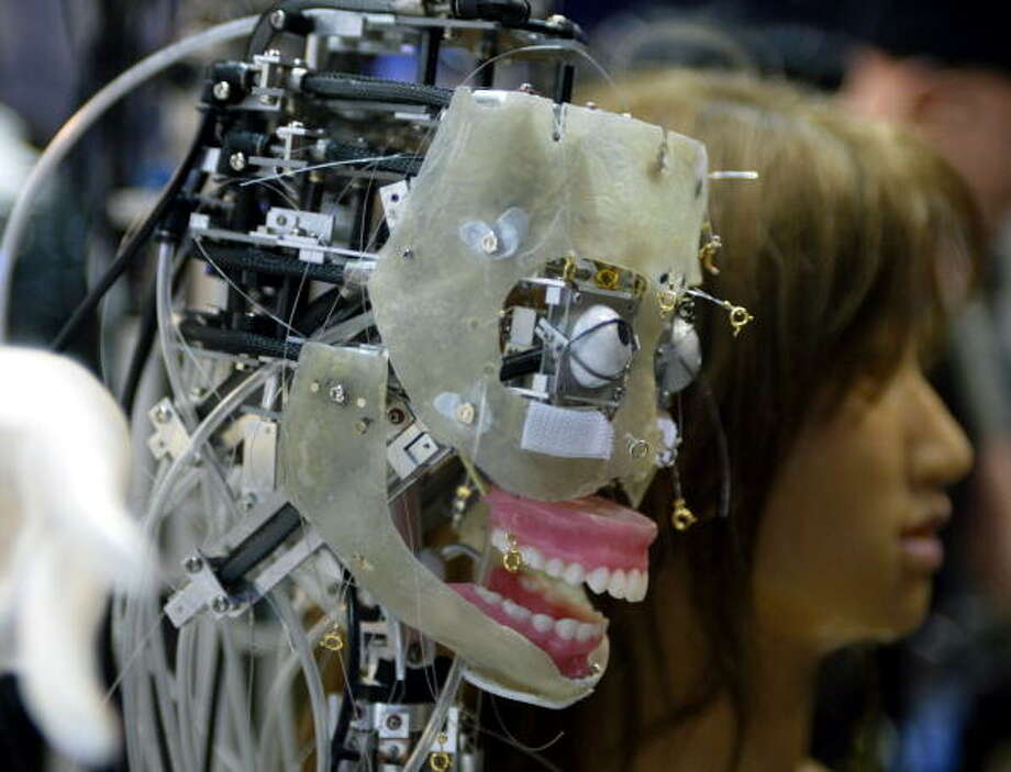 "The Science University of Tokyo's face robot, ""Saya"" is displayed in Japan's biggest robot exhibition, Robodex 2002 in Yokohama 30 March 2002. Saya, developed by associate professor Hiroshi Kobayashi, equipped with 18 shape-memory alloy muscles that enable it to show happiness, sadness, surprise, fear, anger and disgust.  AFP PHOTO / TOSHIFUMI KITAMURA Photo: TOSHIFUMI KITAMURA, Getty / AFP"
