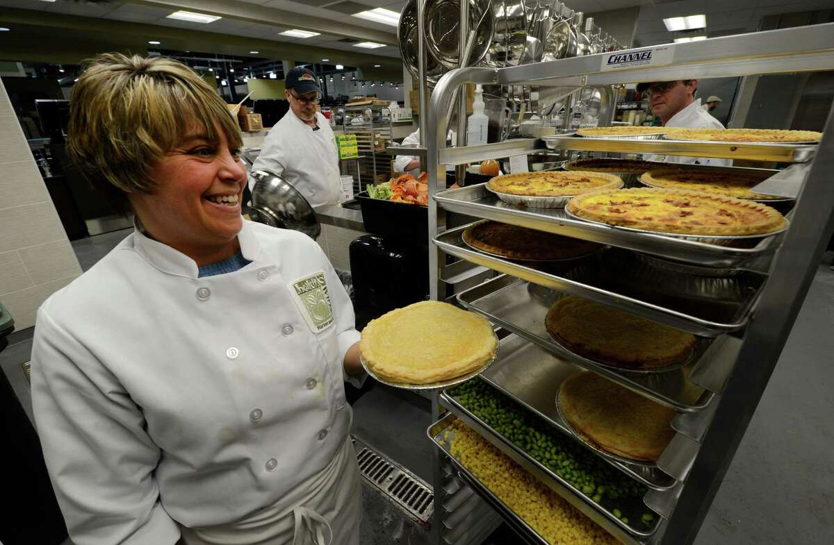Assistant chef Tracie Shattuck holds a fresh quiche at the new Healthy Living market and cafe March 20, 2013 which opens for business tomorrow at the Wilton Mall in Wilton, N.Y. (Skip Dickstein/Times Union)