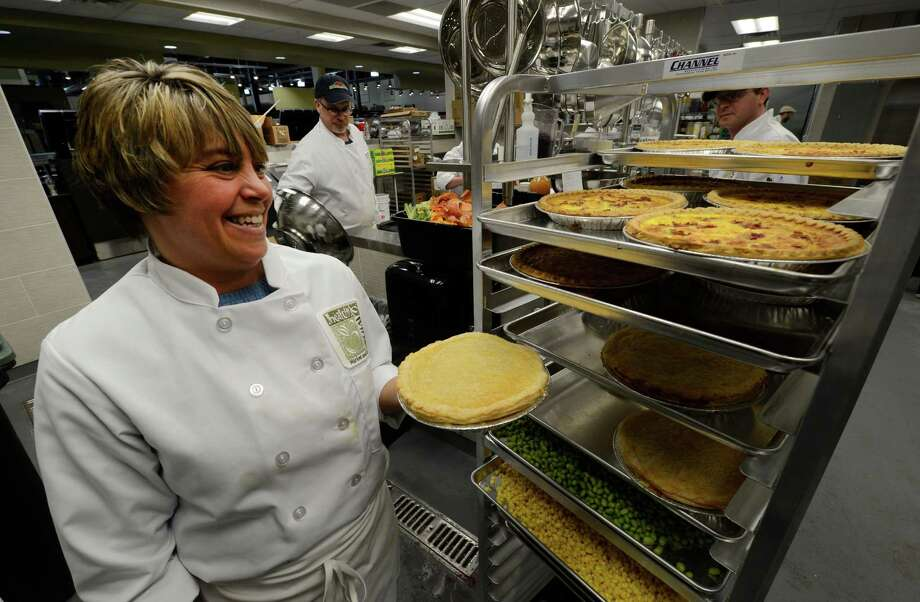 Assistant chef Tracie Shattuck holds a fresh quiche at the new Healthy Living market and cafe March 20, 2013 which opens for business tomorrow at the Wilton Mall in Wilton, N.Y. (Skip Dickstein/Times Union) Photo: SKIP DICKSTEIN / 10021541A