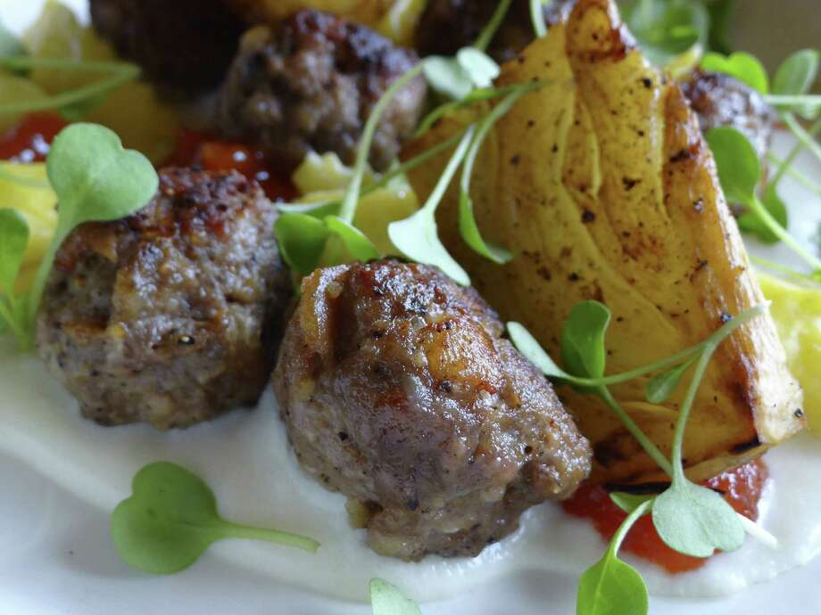 Black pepper meatballs are among the intriguing choices at Bin 555 in The Alley. Photo: Billy Calzada / San Antonio Express-News