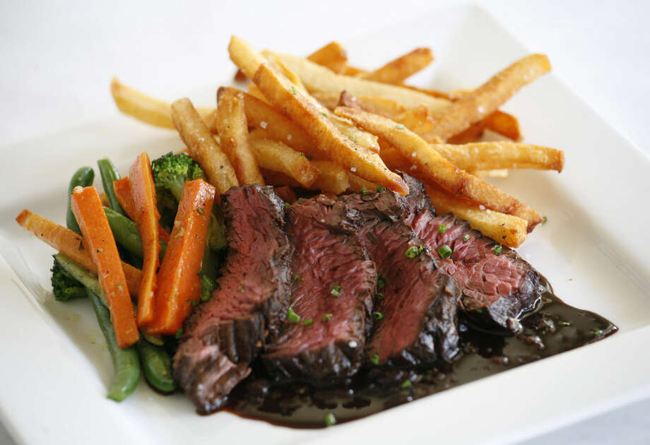 Steak frites are a popular choice at La Frite Belgian Bistro in Southtown. Photo: J. Michael Short / For The San Antonio Express-News