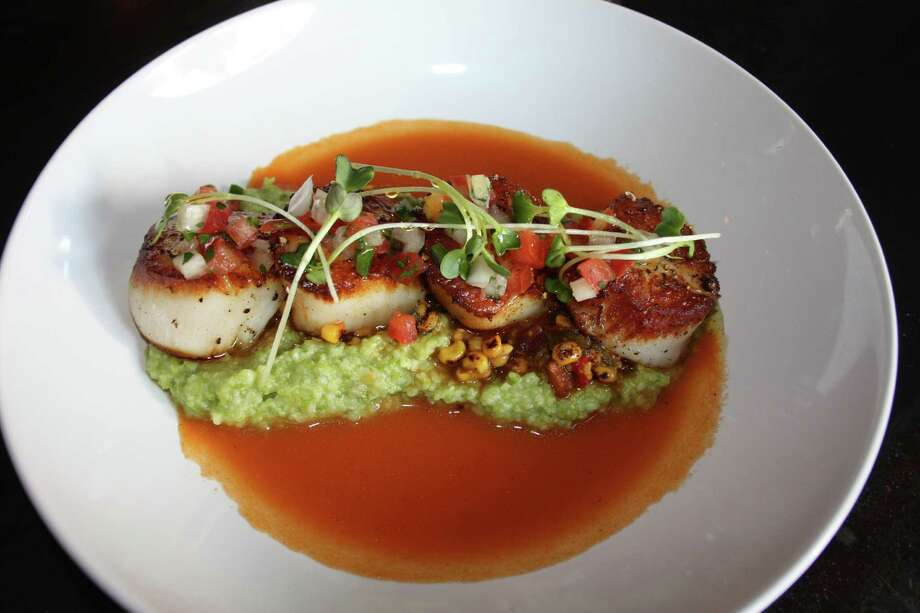 Just a Taste: Scallops with green chile corn grits is a highlight of the menu at Arcade Midtown Kitchen. Photo: Jennifer McInnis / San Antonio Express-News