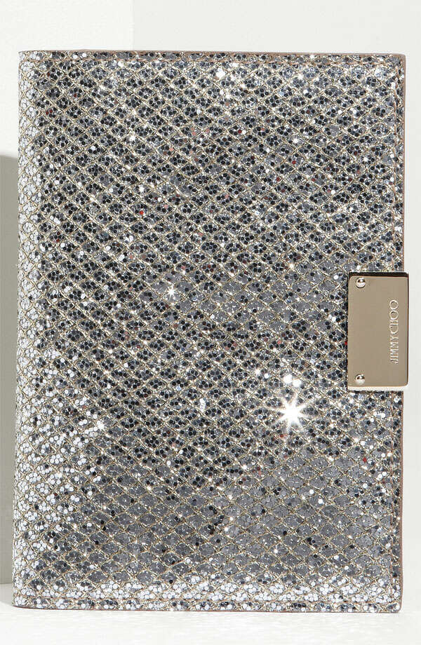 GOLD STATUSLosing your passport will never be an issue again with Jimmy Choo's blingy Reno passport cover in a champagne-colored glitter fabric; $260 at Nordstrom.