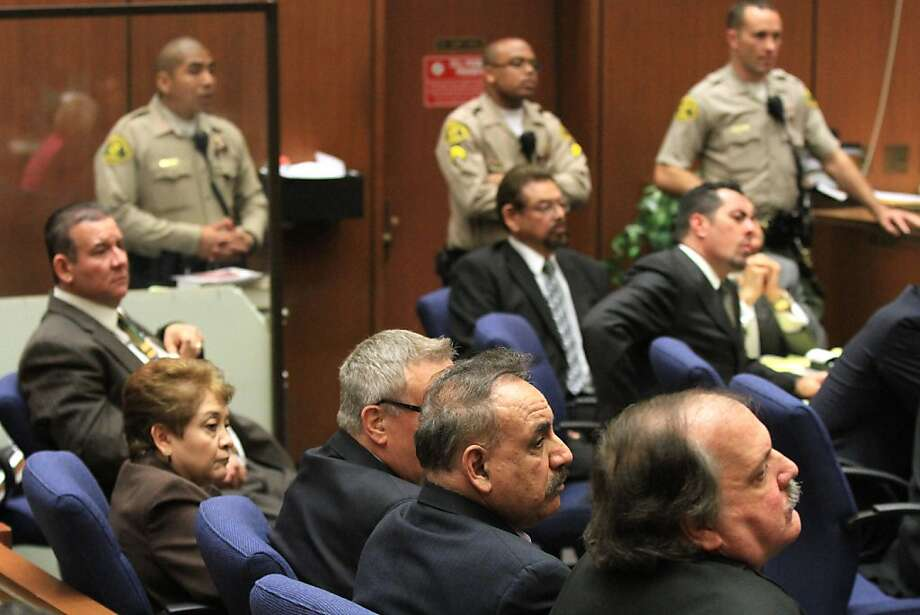George Mirabal (with glasses and beard), Luis Artiga (left), Teresa Jacobo, George Cole, Oscar Hernandez and Victor Belo listen to the verdict. Photo: Pool, Getty Images