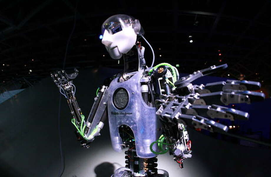 "An interactive robot is on show at the exhibition ""Robo & Co."" on show at the science museum in the northern German city of Wolfsburg on March 6, 2010. AFP PHOTO DDP / RONNY HARTMANN  GERMANY OUT Photo: AFP, Getty / 2010 AFP"