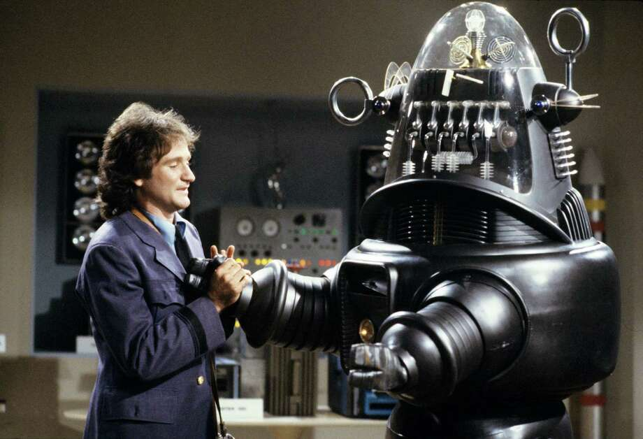 In 1979, Mork (Robin Williams), of Mork and Mindy fame, befriended a robot (Bob Short) in a science museum. Photo: ABC PHOTO ARCHIVES, Getty / ©1979, ABC Photo Archives. All rights reserved. For editorial use only. NO ARCHIVING, NO RESALE.