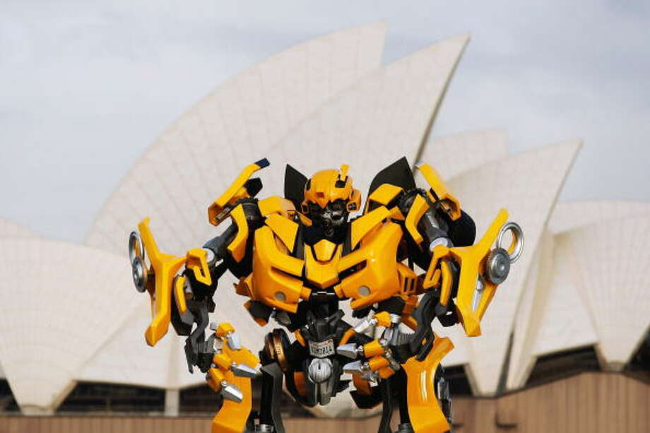"Transformers robot Bumblebee, which stands at 5 metres tall and weighs 3 tonnes, tours Sydney harbour by barge to launch the DVD of ""Transformers: Revenge Of The Fallen"" at Mrs Macquaries Chair on November 5, 2009 in Sydney, Australia. Photo: Brendon Thorne, Getty / 2009 Getty Images"