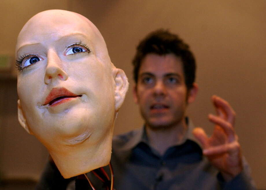 "David Hanson is the creator of ""k-bot"", a robotic face that can change expressions. Hanson, a doctoral student at the University of Texas in Dallas named the robot after his assistant, Kristen Nelson, and debuted the robot at the annual meeting for the American Association for the Advancement of Science in Denver. (Denver Post staff photo by Kathryn Scott Osler) Photo: Kathryn Scott Osler, Getty / Denver Post"