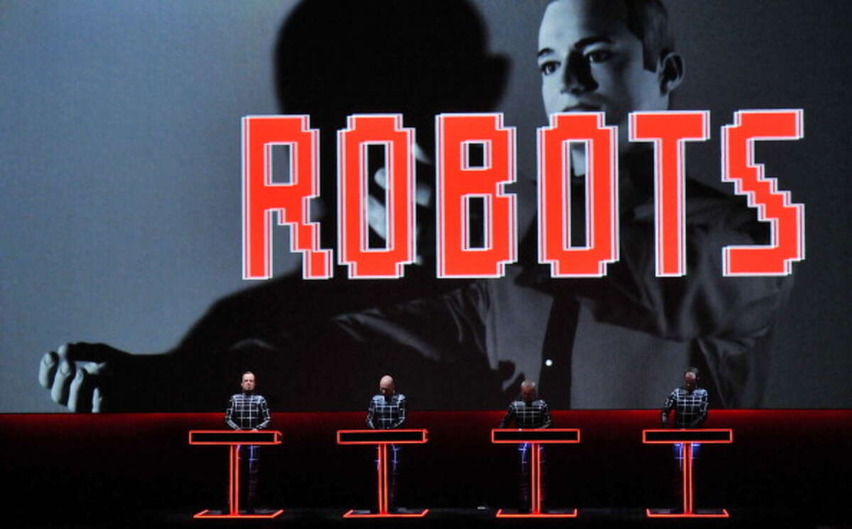 Robots - from simple and course automatons or extension of our own limbs to nearly fully independent automatons challenging the frontiers of artificial intelligence, or at least the appearance of it - robots have inhabited every aspect of our culture since the idea first popped into our species' heads hundreds of years ago.Now, the National Science Foundation has awarded money to a group of scientists who want to create the technology for printing a robot. You'll be able to dream up some task for a robot, design one or select a design and print it out for use wherever you are (as long as you have access to the right kind of printer, of course).In the following gallery, we look at our love affair with robots spanning the decades.German electronic pioneers Kraftwerk perform live on stage during the first night of their Catalogue 12345678 retrospective at the Tate Modern Turbine Hall on February 6, 2013 in London, England.