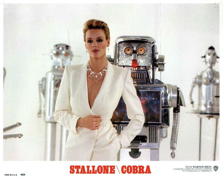 Brigitte Nielsen standing in front of robots in a scene from the film 'Cobra', 1986. Photo: Archive Photos, Getty / 2012 Getty Images