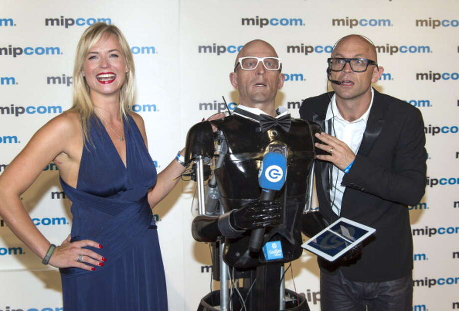 Jason Bradbury and his Robot attend the Mipcom Opening Party at Martinez hotel  on October 8, 2012 in Cannes, France. Photo: Didier Baverel, Getty / 2012 Didier Baverel