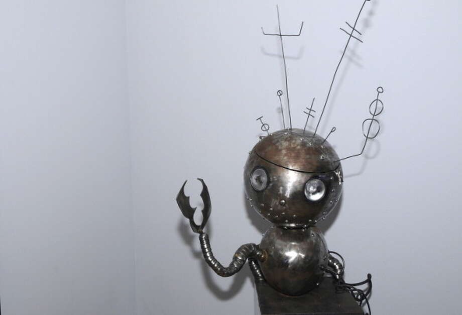 "Now for the odd and wonderful in robotics.A piece by Tim Burton Exhibit at The Museum of Modern Art"" in New York City on November 16, 2009 -- Pictured: Robot Boy statue Photo: Syfy, Getty / 2012 NBCUniversal, Inc."