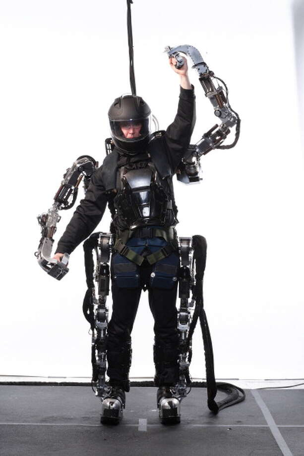The XOS, is the latest and arguably most advanced exoskeleton in existence, developed by one-man idea factory Steve Jacobsen and the engineers at Sarcos, a robotics company he started in 1983 that was recently purchased by the defense giant Raytheon. Show here the Exoskeleton test pilot Rex Jameson greets XOS maker Steve Jacobsen. Photo: John B. Carnett, Getty / Bonnier Corporation