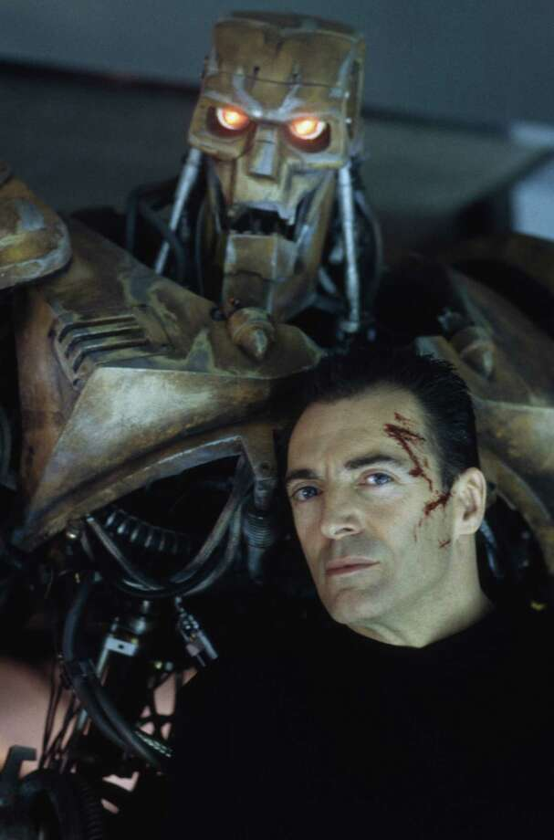 American actor Armand Assante as the psychotic Rico with his combat robot in the dystopian sci-fi film 'Judge Dredd', 1995. Photo: Richard Davis, Getty / 2011 Richard Blanshard