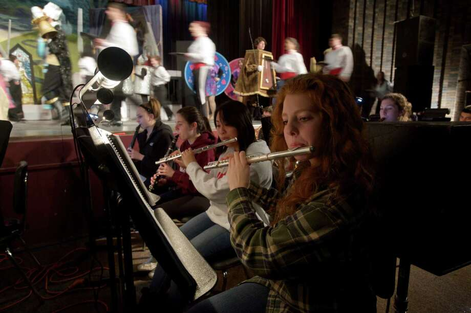 "Eliza Wagman, 15, a sophomore at Bethel High School  plays the flute in the school's production of Disney's ""Beauty and the Beast"". Next to her, left, is Soo Cho,16, a junior who also plays the flute. Photo: H John Voorhees III / The News-Times Freelance"