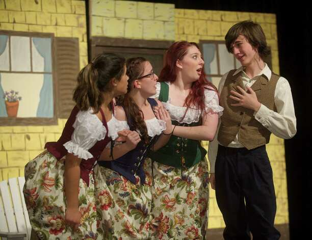 "Playing the Silly Girls in ""Beauty and the Beast"" are, from left, Sara Islam,16, Kelly Roper, 16, and Caroline Renner, 17, all  juniors at Bethel High School in Bethel, Conn. They are singing with Timmy Sheehan the understudy for Gaston during rehearsal Tuesday, March 19, 2013. Photo: H John Voorhees III / The News-Times Freelance"