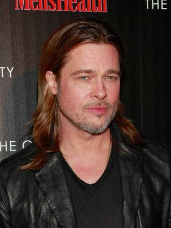Brad Pitt was photographed sunbathing naked in 1995 while on vacation with then-girlfriend Gwyneth Paltrow. The photos were released on the Internet and published in Playgirl in 1997. Photo: Charles Eshelman, FilmMagic / 2012 Charles Eshelman